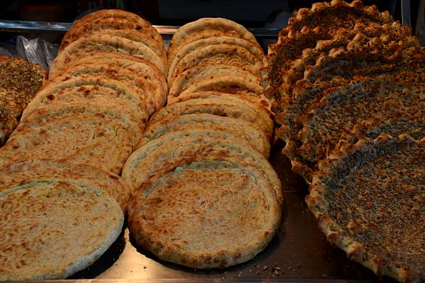 Muslim bread in Xi'an, Shaanxi, China Muslim bread for sale at one of the many food stalls in the Muslim Quarter of Xi'an. The area has become a famous attraction of Xi'an for its profound Muslim cultural atmosphere.  muslim quarter stock pictures, royalty-free photos & images