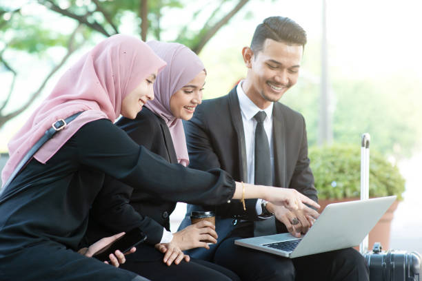 Muslim business people Muslim business people discussion with laptop, outdoor. business Malaysia stock pictures, royalty-free photos & images