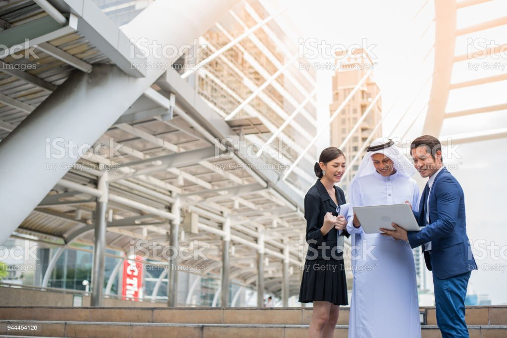 muslim businessman and business people looking to notebook and talk about business plan. excitement for business success. muslim businessman and business people looking to notebook and talk about business plan. excitement for business success. Adult Stock Photo