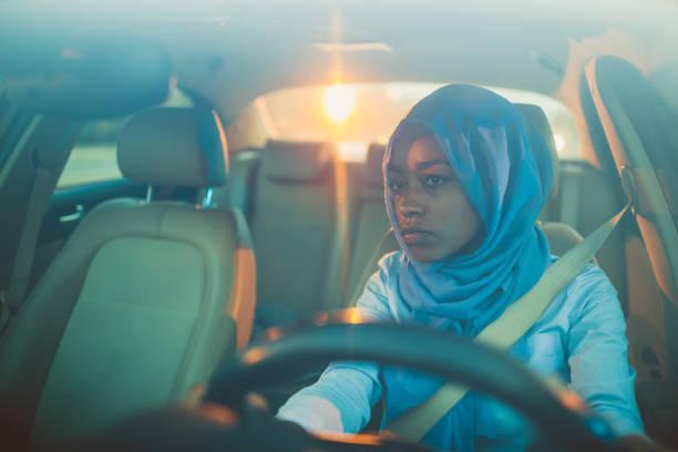A Muslim businesswoman driving a car stock photo