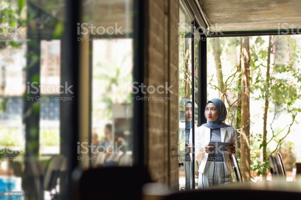 Muslim Businesswoman Working At A Cafe stock photo
