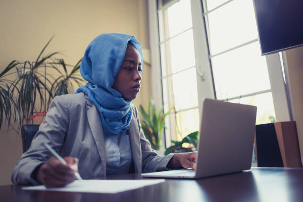 Muslim businesswoman working at home stock photo
