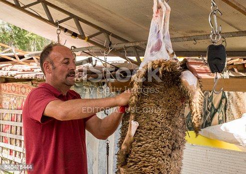 istock Muslim butcher man cutting a sheep for Eid Al-Adha (Sacrifice Feast). 840478444
