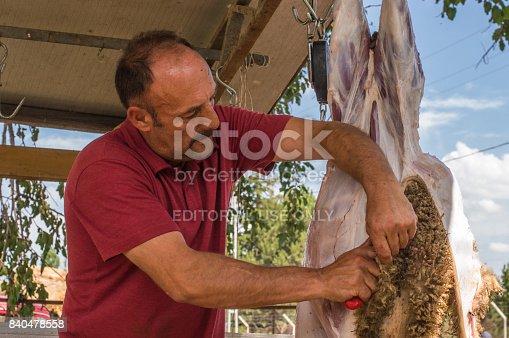 istock Muslim butcher man cutting a sheep for Eid Al-Adha (Sacrifice Feast). 840478558