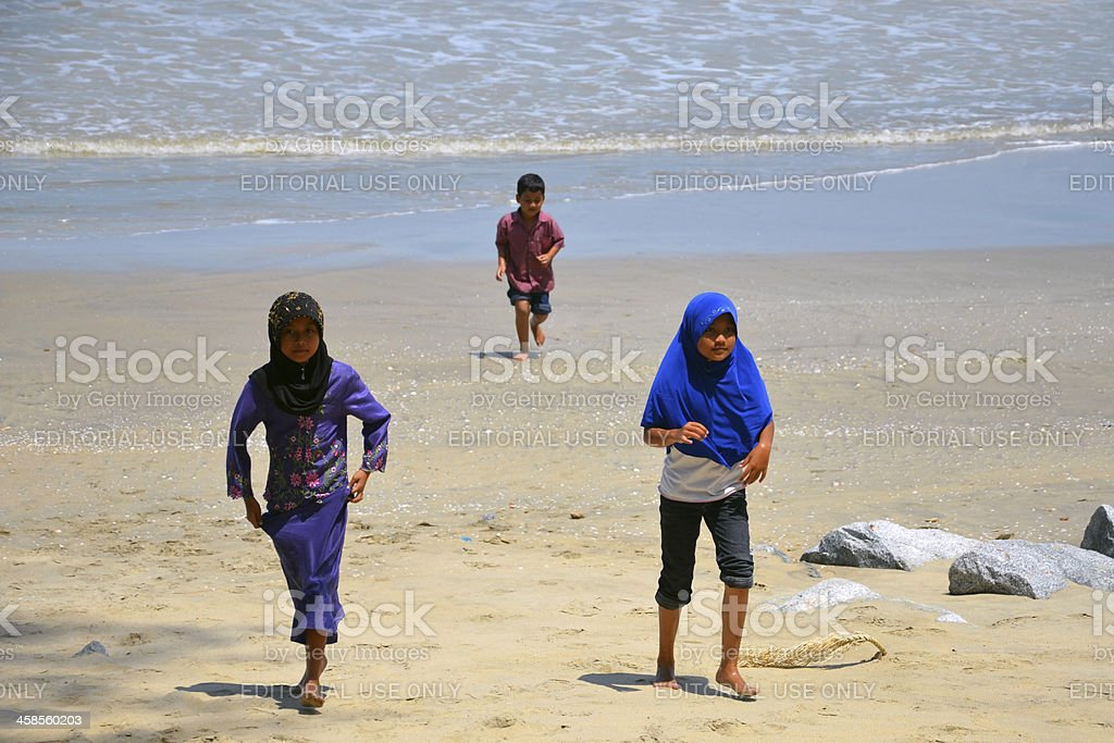 Muslim children on the Beach in Malaysia royalty-free stock photo