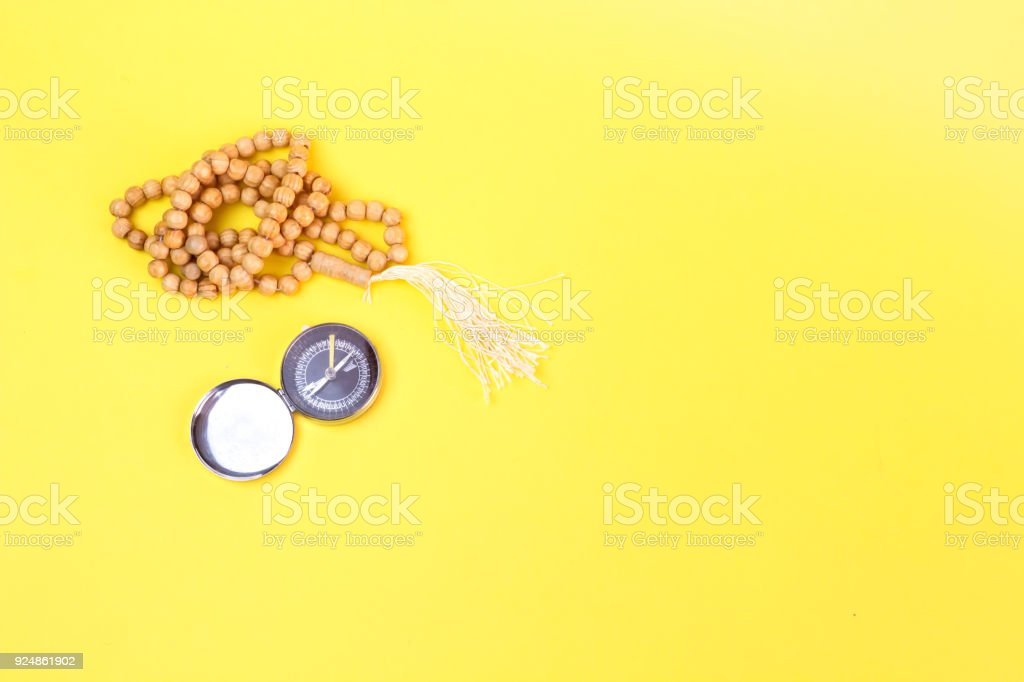 muslim compass,direction of Kaaba and yellow rosary stock photo