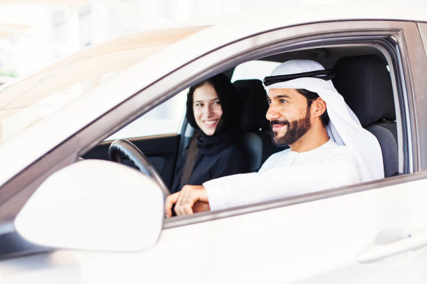 Muslim couple on a ride stock photo