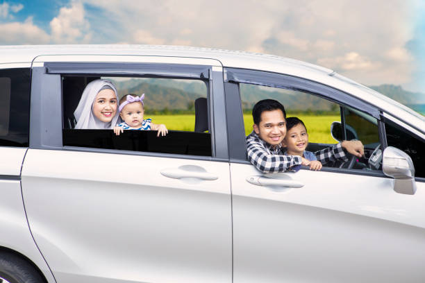 muslim family driving for travel on vacation - asian travel in car stock photos and pictures