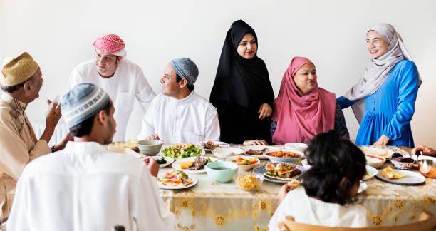 Muslim family having a Ramadan feast Muslim family having a Ramadan feast middle eastern culture stock pictures, royalty-free photos & images