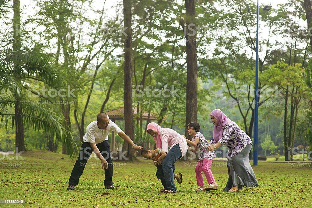 Muslim family having fun at outdoor royalty-free stock photo