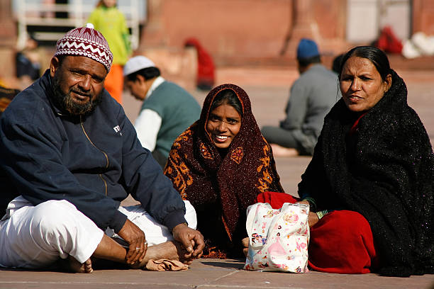 Muslim family Dehli, India- February 11, 2008: Muslim family on pilgrimage to Jama Masjid mosque on February 11, 2008 in Dehli, India. Jama Masjid is the largest mosque in India with millions of visitors each year. agra jama masjid mosque stock pictures, royalty-free photos & images