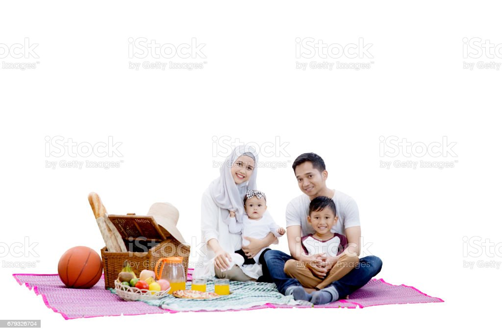 Muslim family with picnic basket stock photo