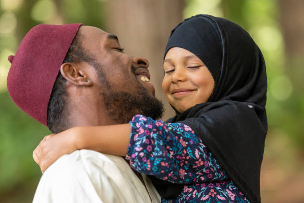 Muslim father and daughter at her first day of school Black Muslim father and daughter at her first day of school islam stock pictures, royalty-free photos & images