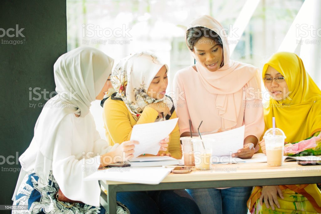 Muslim Female College Study Group At Work In Cafe Stock Photo Download Image Now Istock