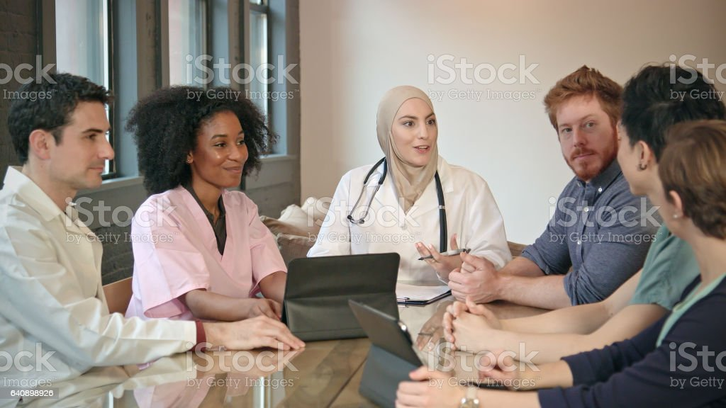Muslim Female Doctor Leads Multi-Ethnic Medical Team WS stock photo