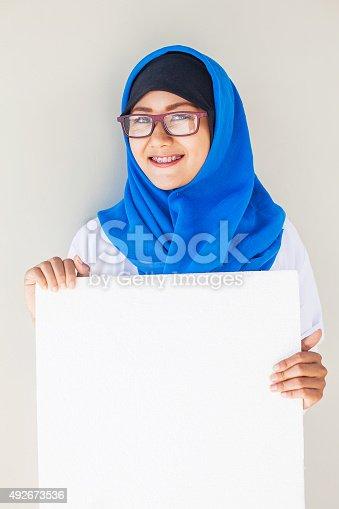 istock muslim female doctor's portrait 492673536