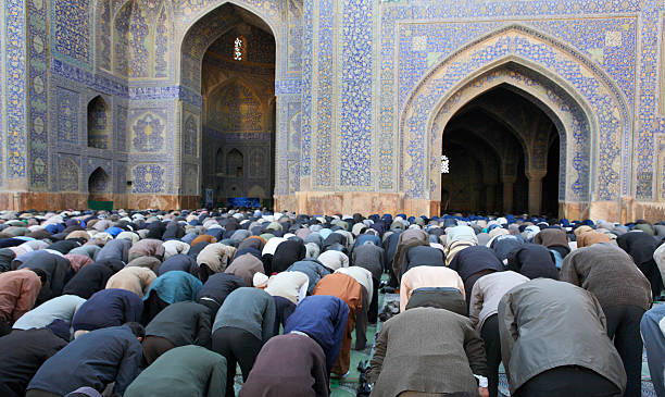 Muslim Friday mass prayer in Iran stock photo