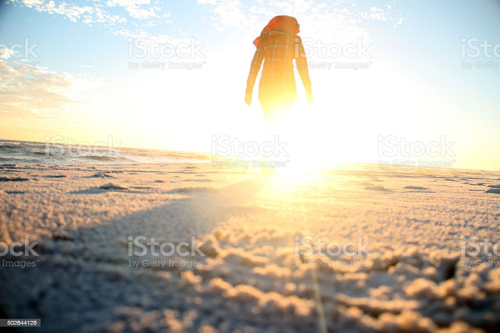 Muslim girl going towrds the sun stock photo
