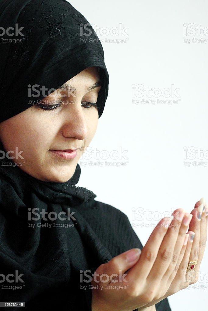 Muslim girl praying royalty-free stock photo