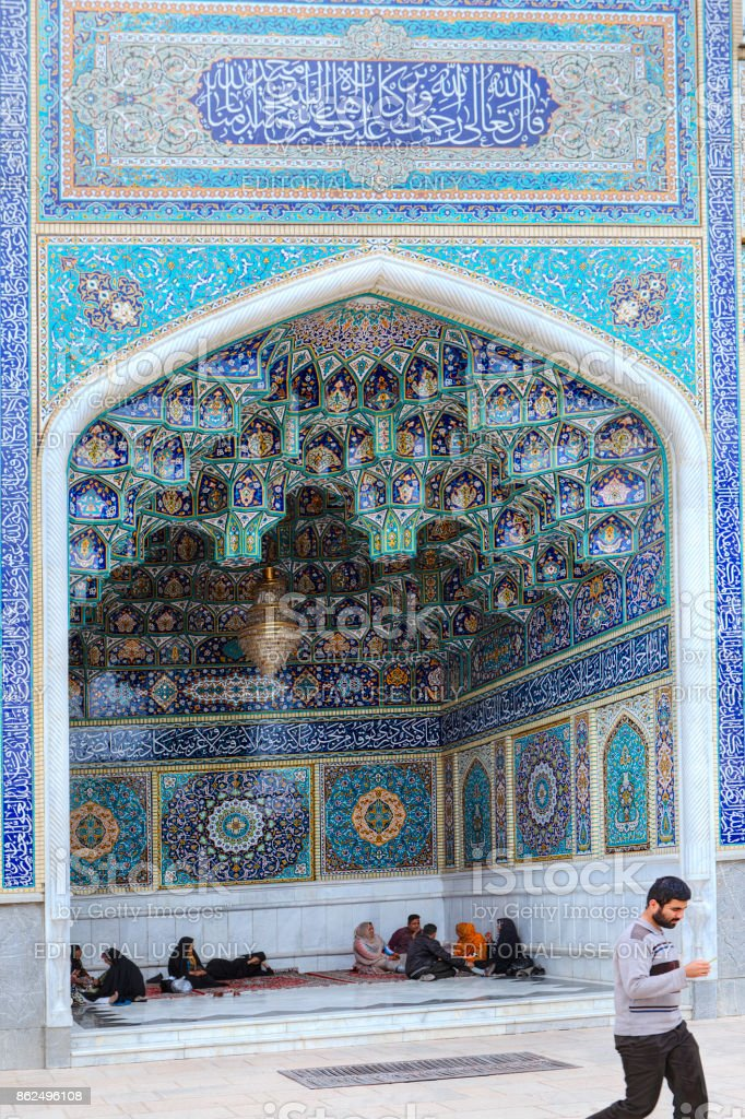 Muslim group rests in a niche of mosque, Shiraz, Iran. stock photo