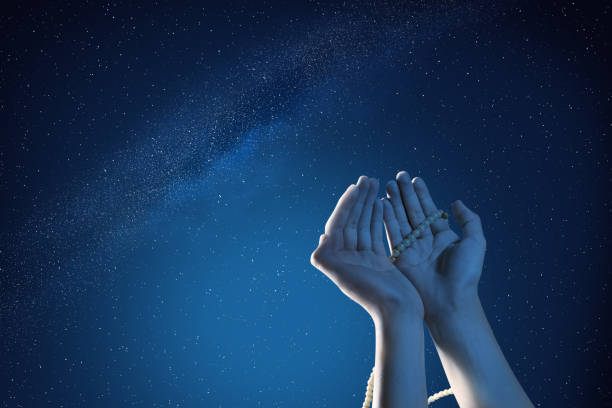 Muslim hands praying with prayer beads at outdoor Muslim hands praying with prayer beads at outdoor with night scene background islam stock pictures, royalty-free photos & images