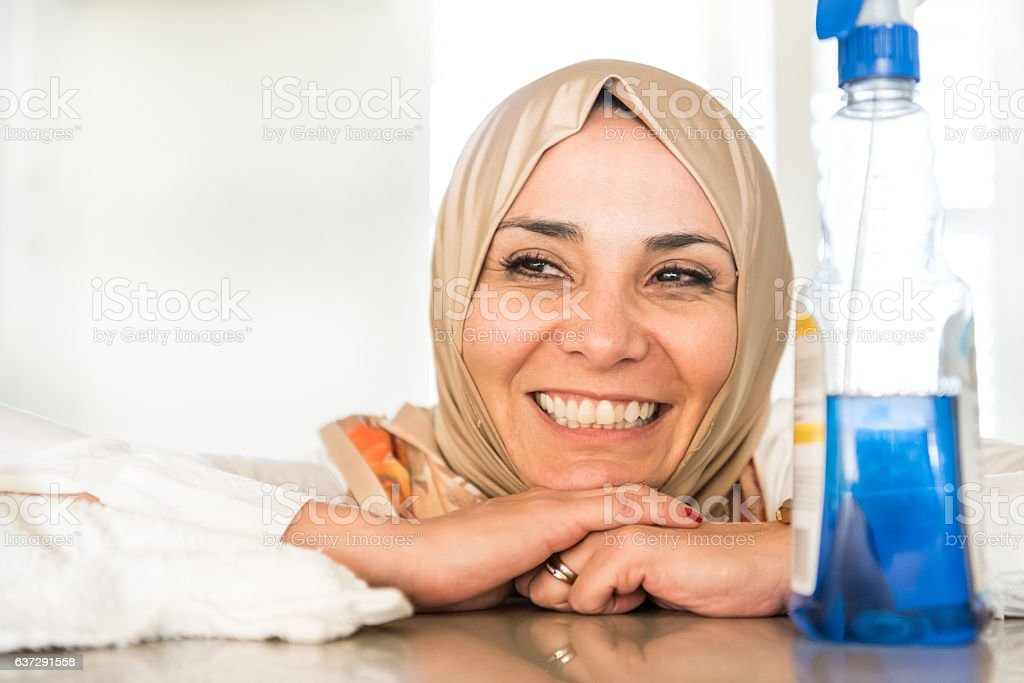 Muslim housewife posing at her kitchen stock photo