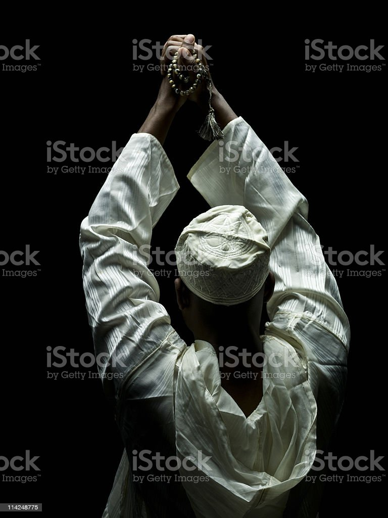 Muslim Man Holding Prayer Beads stock photo