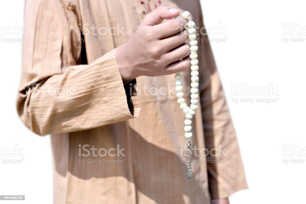 Muslim man holding prayer beads - Royalty-free Adult Stock Photo