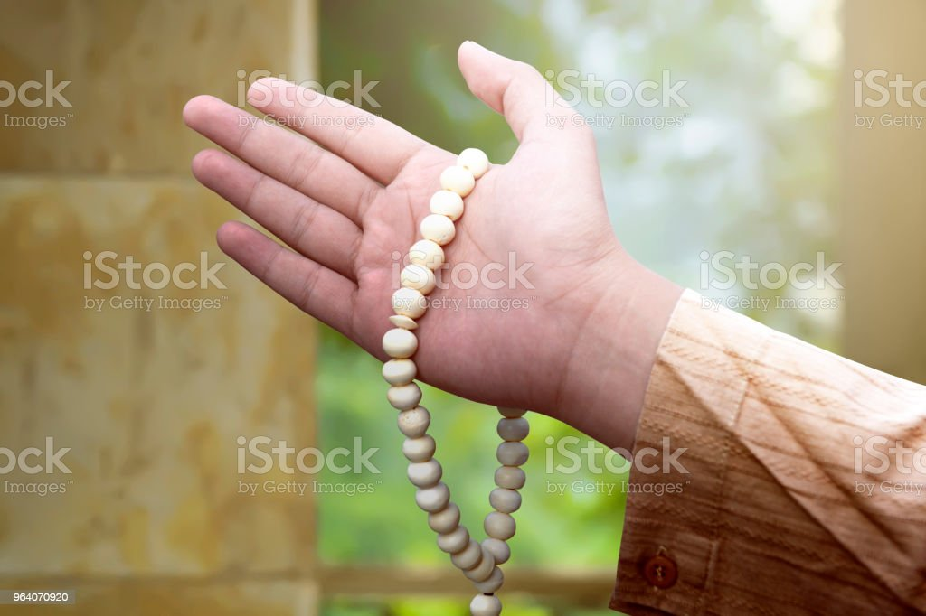 Muslim man holding prayer beads - Royalty-free Adult Stock Photo