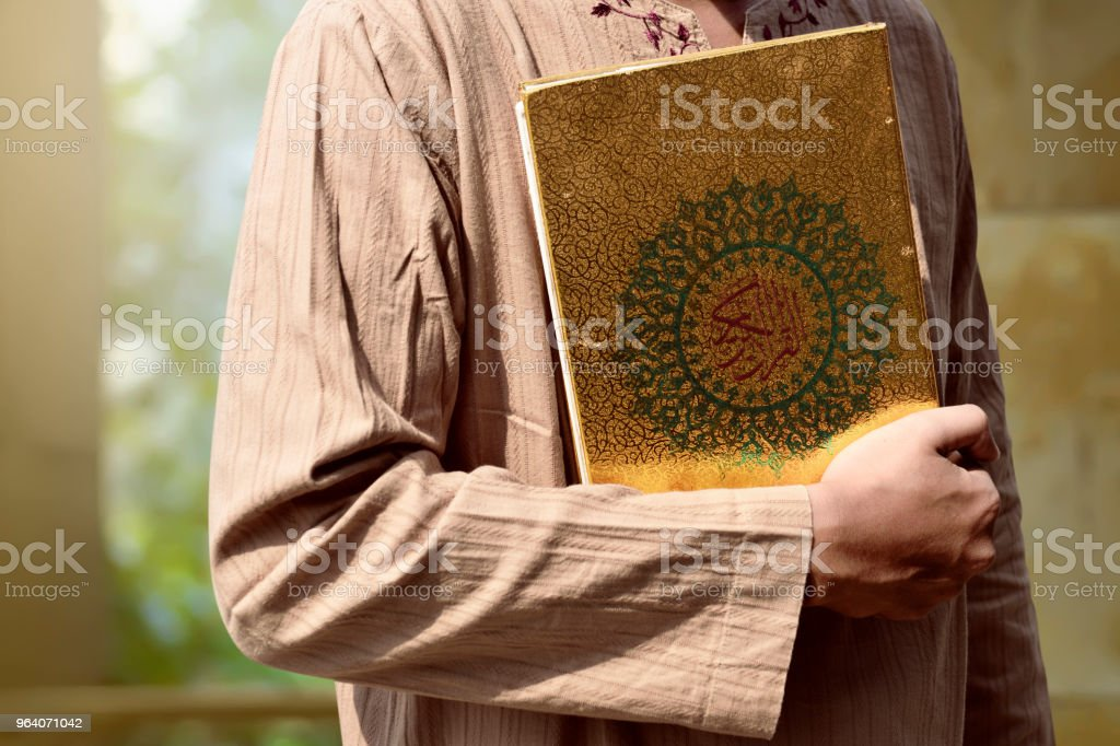 Muslim man holding Quran - Royalty-free Adult Stock Photo