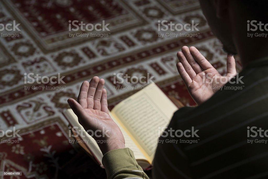 Muslim Man Is Reading The Koran royalty-free stock photo