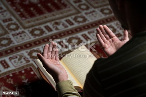 istock Muslim Man Is Reading The Koran 504854169