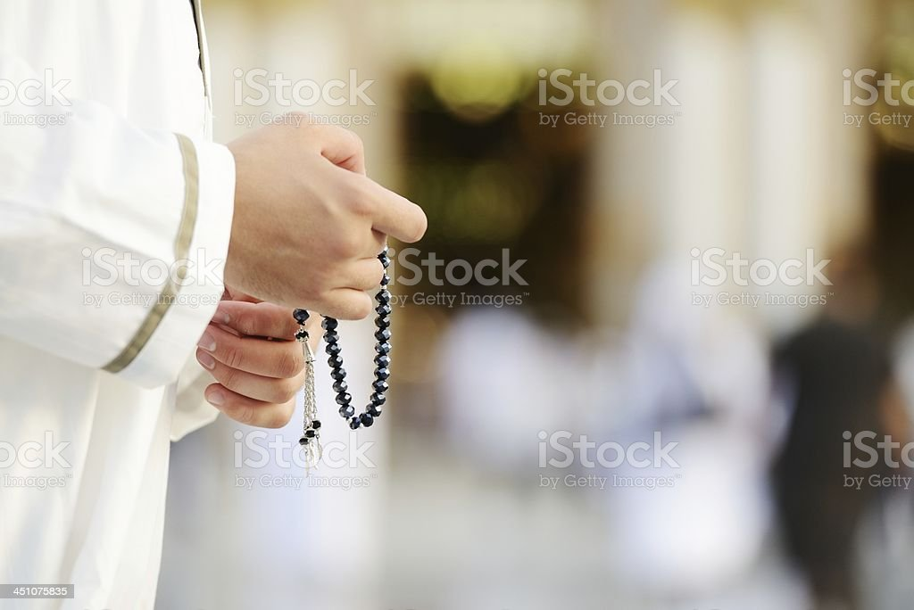 Muslim man praying at holy mosque wearing white stock photo