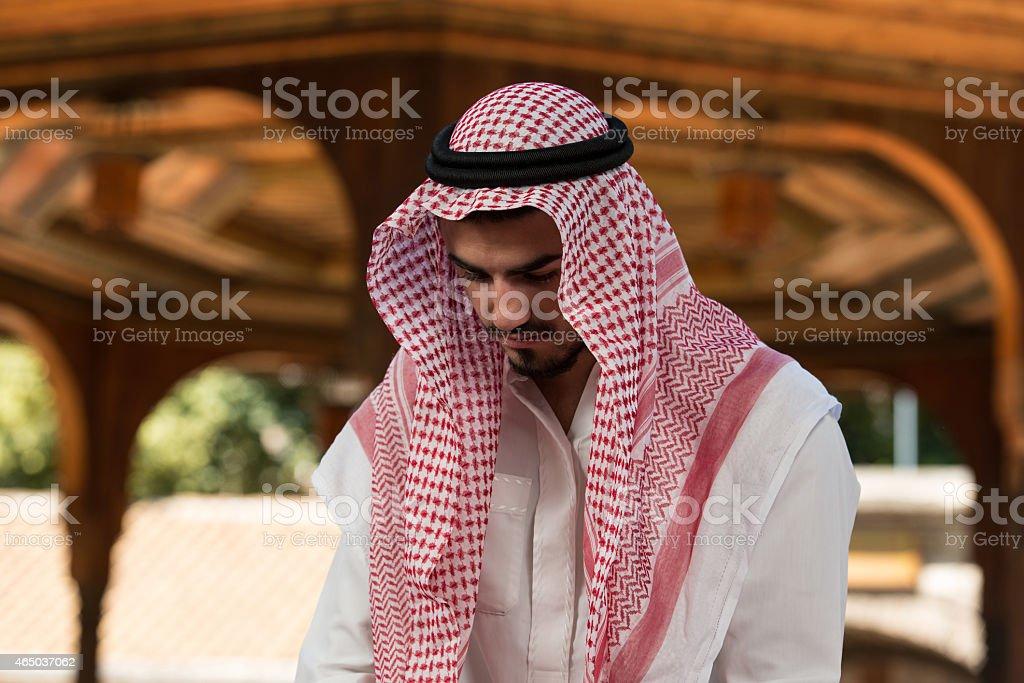 Muslim Man Praying At Mosque stock photo