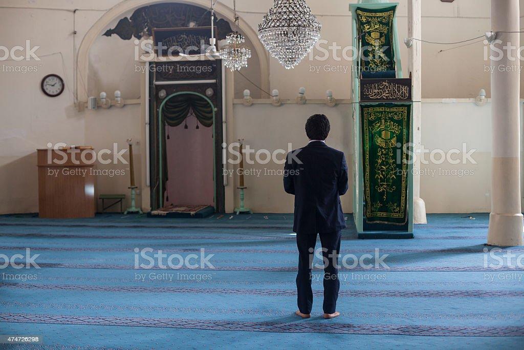 Muslim Man Praying In Sultan Alaaddin Mosque, Antalya,Turkey stock photo