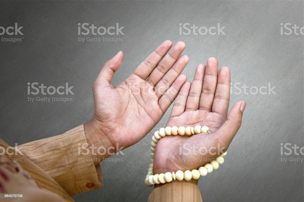 Muslim man praying with prayer beads - Royalty-free Adult Stock Photo