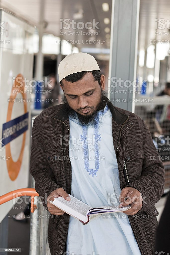 Muslim man Reading the Koran in London royalty-free stock photo