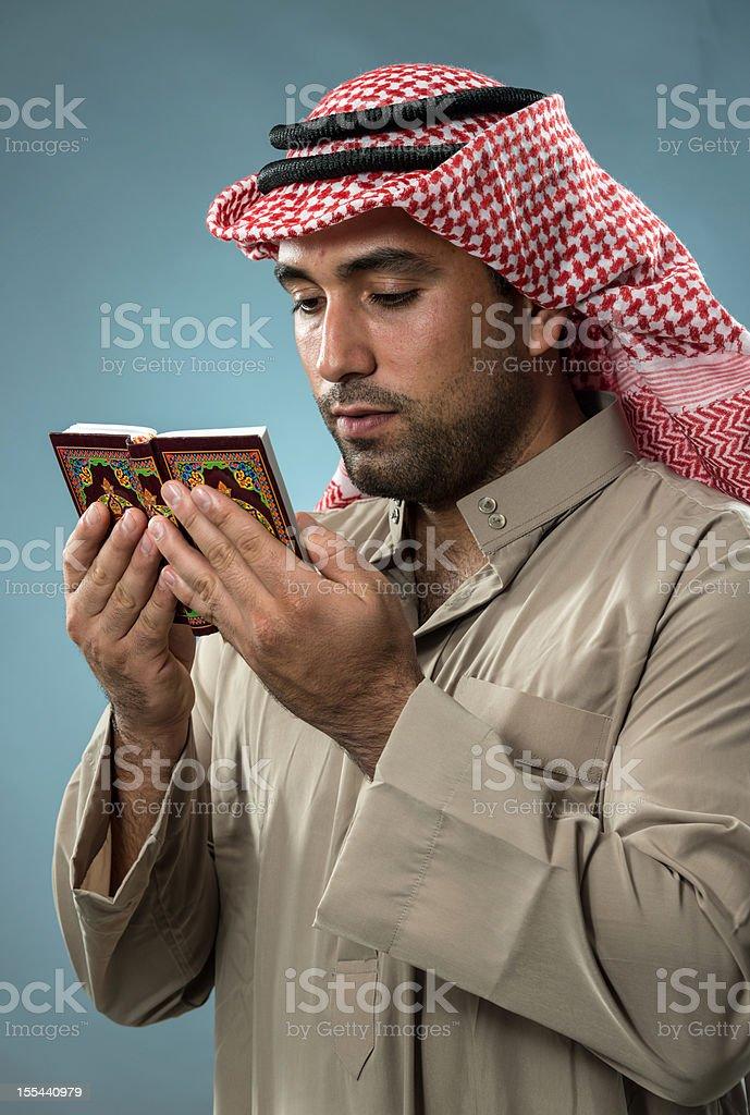 Muslim man reading the Koran royalty-free stock photo