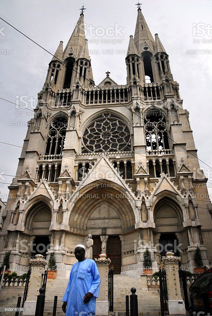 Muslim man stands under the Cathedral, Cathedrale de la Major stock photo