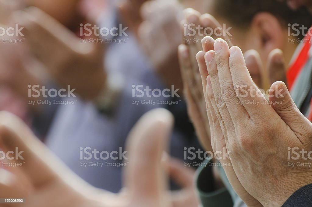 Muslim men praying with lifted hands in Cairo, Egypt stock photo