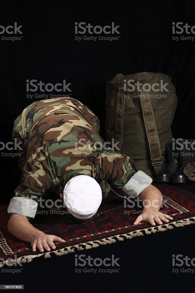 Muslim Military Man Prays stock photo