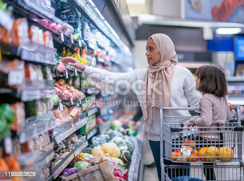 istock Muslim Mother and Daughter Grocery Shopping stock photo 1193353829