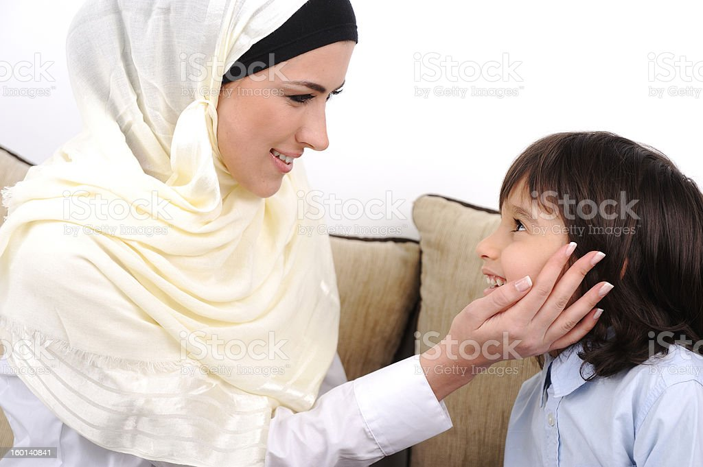 Muslim mother and son relaxing at the home royalty-free stock photo