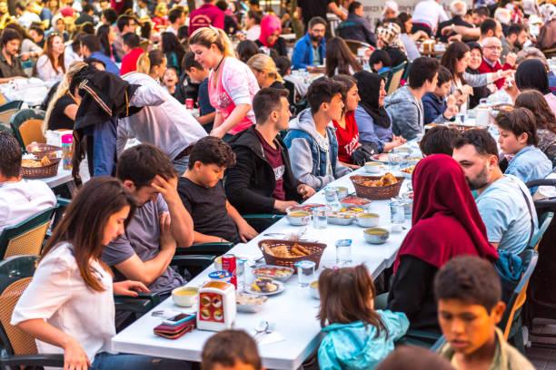 Cтоковое фото Muslim people gather to eat together for Ramadan kareem