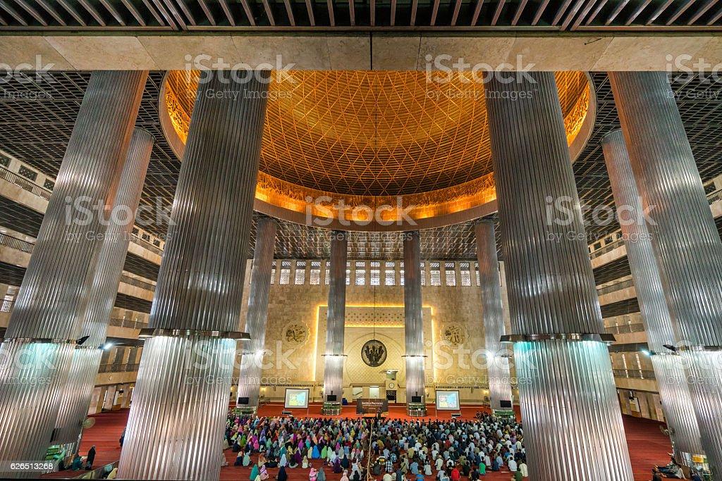 Muslim People praying in Istiqlal Mosque, Jakarta, Indonesia stock photo