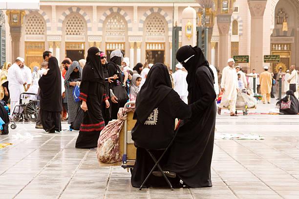 muslim pilgrims, medina, saudi arabia - saudi woman stock photos and pictures