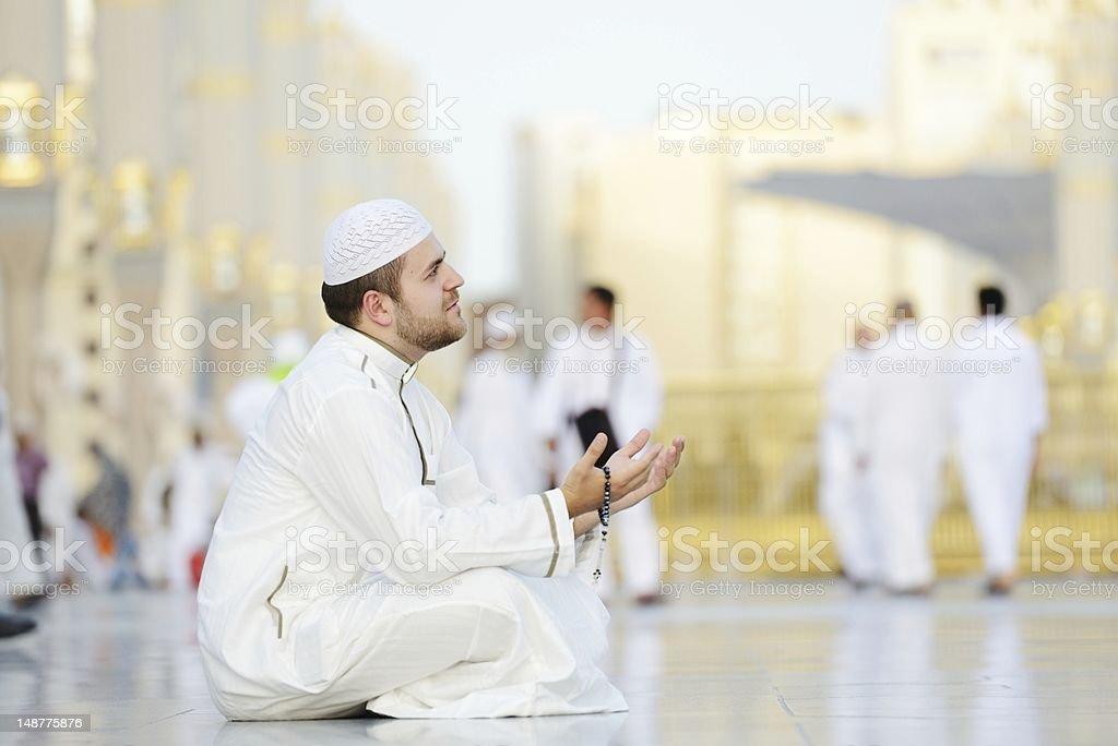 Muslim prayer at holy mosque stock photo