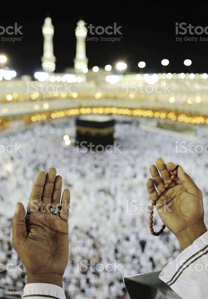 Muslim praying at Makkah with hands up stock photo