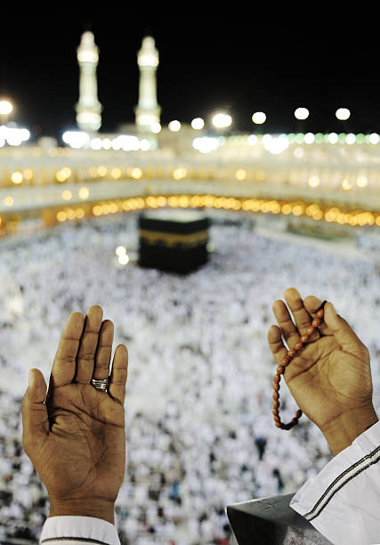 Muslim praying at Makkah with hands up Visiting Kaaba in Makkah, black and white with copy space circumambulation stock pictures, royalty-free photos & images