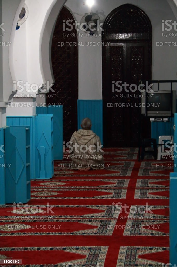 Muslim praying in a mosque stock photo